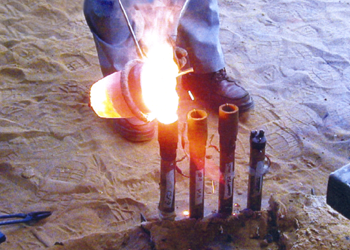 Pouring molten metal to the cups.